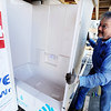 Globe/T. Rob Brown<br /> Joplin Supply Company driver Tom Weens delivers a tub-shower for a Habitat for Humanity house Wednesday afternoon, Feb. 1, 2012, at 902 Central in Joplin.