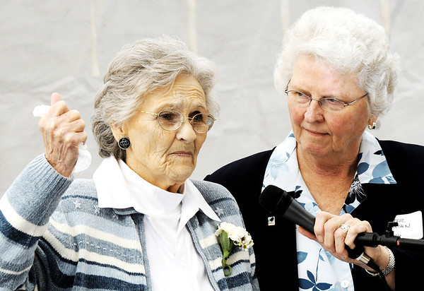 Globe/T. Rob Brown<br /> Resident Bonnie Betz, left, recalls her experience the day of May 22, 2011, as Sister Lillian, CEO Mercy Housing Inc, holds the microphone for her Tuesday morning, Feb. 21, 2012, during the grand re-opening of Mercy Village in Joplin.