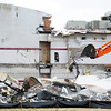 Globe/T. Rob Brown<br /> Urban Metro Development, of Atlanta, Ga., operators tear down the northeast walls of the tornado-ravaged Joplin High School Friday afternoon, Feb. 17, 2012.