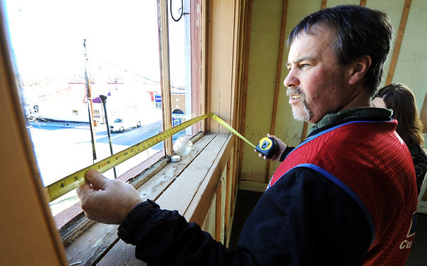 Globe/T. Rob Brown<br /> Rick Eramo, commercial sales specialist with Lowe's in Neosho, measures one of a series of tall windows on the second floor of the McDonald County Courthouse Friday morning, Feb. 24, 2012, in Pineville. Eramo measured the windows so they can be replaced.