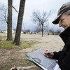 Globe/T. Rob Brown<br /> Tim Frevert, owner of Community Forestry Consulting, a consultant for the Missouri Conservation Department, examines the location of trees compared to a satelite map Tuesday afternoon, Feb. 7, 2012, at Parr Hill Park. He is helping with the tree plan for the park. Trees, like the one at left, are dead or severely damaged trees slated for removal.