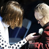Globe/T. Rob Brown<br /> Mercy Village resident Betty Robinson, right, gets a flower from Sarah Hunt, with PricewaterhouseCoopers (PWC), of Chicago Tuesday morning, Feb. 21, 2012, during the grand re-opening of Mercy Village in Joplin.