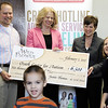 Globe/T. Rob Brown<br /> Justin Thomas, owner of the Wild Flower, left, presents a check for $6,500 to the Ozark Center for Autism as the group laughs over three-year-old Ethan smiling for photographers Thursday afternoon, Feb. 2, 2012, at the Ozark Center for Autism in Joplin. Pictured, from left, are: Thomas, Paula Baker, president and CEO of Freeman Health System and administrator for autism programming, Heather Collier, director of community and donar relations, and Jennifer Kirby, clincial director.
