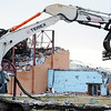 Globe/T. Rob Brown<br /> Construction workers remove debris from Joplin High School Tuesday afternoon, Feb. 14, 2012.