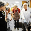 Globe/T. Rob Brown<br /> Rachel Quisenberry, left, a choclateer from Westwood Hills, Kan., with Annedore's Fine Chocolates, listens as instructor Jim Bourne, right, of West Bridgewaer, Mass., demonstrates chocolate-making techniques Monday afternoon, Feb. 20, 2012, at the Candy House, Joplin chocolate factory.