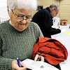 Globe/T. Rob Brown<br /> Darlene LaGasse, left, of Joplin, looks over the choices on her absentee ballot Friday afternoon, Feb. 3, 2012, in the Jasper County Clerk's Office at the Joplin Courts Building. She and her husband, Louis, background, help as election judges on election day and are unable to make it to their appropriate polling place so they vote absentee.