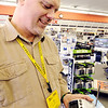 Globe/T. Rob Brown<br /> Phil Jones, owner of Radio Shack, on Maiden Lane Road and 8th Street in Joplin, operates a weather radio sold in his store Thursday afternoon, Feb. 9, 2012.