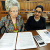 Globe/T. Rob Brown<br /> Pam Roychaudhury, right, staff attorney with Legal Aide of Western Missouri and the Voices in Court attorney, looks through paperwork with Janice Franklin, Legal Aide managing attorney, Thursday morning, Feb. 23, 2012, in the Economic Security building in downtown Joplin. Voices in Court, which helps people in need of legal assistance, is one of the charitable organizations that receive funding from United Way.
