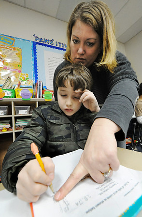 Globe/T. Rob Brown<br /> Student teacher Casi Shaw, of Baxter Springs, Kan., who is a PSU elementary education major, helps third-grader Kyle Cure with a worksheet problem Wednesday afternoon, Feb. 15, 2012, at Liberty Elementary School in Galena, Kan.