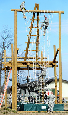 Globe/T. Rob Brown<br /> National Guard air assault trainees traverse one of the major obstacles Tuesday morning, Feb. 28, 2012, on an obstacle course at Camp Crowder in Neosho. About 200 soldiers started their air assault training.