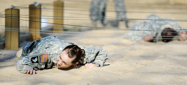 Globe/T. Rob Brown<br /> 1st Lt. Heather Adams, of St. Louis, craws through sand Tuesday morning, Feb. 28, 2012, on an Army National Guard obstacle course at Camp Crowder in Neosho. About 200 soldiers started their air assault training.