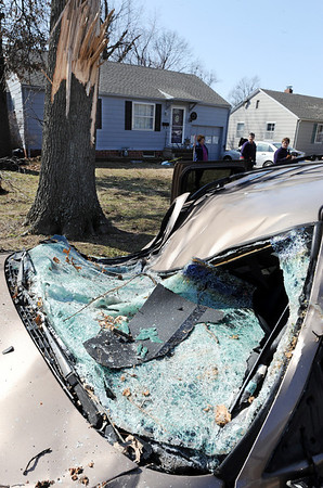 Globe/T. Rob Brown<br /> One of several severely-damaged vehicles in the 400 block of Fieldcrest hit by falling trees during Tuesday night's severe storm, as seen Wednesday morning, Feb. 29, 2012, in Pittsburg, Kan.