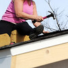 Globe/T. Rob Brown<br /> Deborah Raymond, of Springfield, co-owner of Roofmaster Plus, of Springfield, volunteers her time as she installs a ridge vent on a Habitat for Humanity house Wednesday afternoon, Feb. 1, 2012, at 902 Central in Joplin.