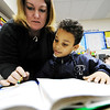 Globe/T. Rob Brown<br /> Student teacher Casi Shaw, of Baxter Springs, Kan., who is a PSU elementary education major, helps third-grader A.J. Holmes with classwork Wednesday afternoon, Feb. 15, 2012, at Liberty Elementary School in Galena, Kan.