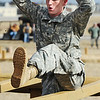 Globe/T. Rob Brown<br /> Spc. Nicholas Wheeler, of Kansas City, Mo., maneuvers over wooden hurdles Tuesday morning, Feb. 28, 2012, on an Army National Guard obstacle course at Camp Crowder in Neosho. About 200 soldiers started their air assault training.