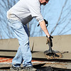Globe/T. Rob Brown<br /> Terry Tholstrup, George Nettels Elementary School maintenance worker, cleans off the school's roof due to Tuesday night's severe storm, in Pittsburg, Kan., on Wednesday afternoon, Feb. 29, 2012.