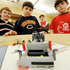 Globe/T. Rob Brown<br /> Fourth graders (from left) Logan Williams and Layne Henning, seventh grader Ian Lawson (background) and fifth grader Eli Lawson watch as Robbie the robot takes off on a programmed mission Wednesday after school, Feb. 8, 2012, at Seneca Intermediate School.