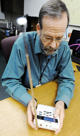 Globe/T. Rob Brown<br /> Keith Stammer, Joplin-Jasper County Emergency Management director, operates a weather radio in his office at the Dr. Donald E. Clark Law Enforcement & Public Safety building in downtown Joplin.
