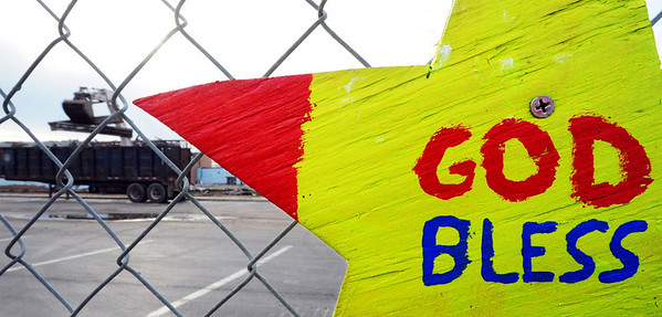 Globe/T. Rob Brown<br /> Decorative signs adorn the Joplin High School fence as construction workers remove debris Tuesday afternoon, Feb. 14, 2012.