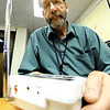 Globe/T. Rob Brown<br /> Keith Stammer, Joplin-Jasper County Emergency Management director, listens to a weather radio in his office at the Dr. Donald E. Clark Law Enforcement & Public Safety building in downtown Joplin.