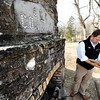 Globe/T. Rob Brown<br /> Dusty Reid, Roaring River State Park superintendent, looks through a history book about the park as he stands next to a fireplace, now part of an outdoor meeting area, that was built by CCC workers during a tour Thursday, Feb. 16, 2012, at the historic park near Cassville.