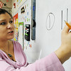 Globe/T. Rob Brown<br /> Student teacher Ashley E. Cook, of Joplin, who is an MSSU elementary education major, writes a mathematics example on the board for a first-grade class Wednesday afternoon, Feb. 15, 2012, at Spring Grove Elementary School in Galena, Kan.