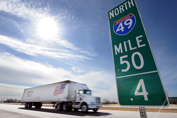 Globe/T. Rob Brown<br /> A tractor trailer travels in the northbound lane of Missouri 71 Highway, soon to be renamed I-49, near Carthage Wednesday morning, Feb. 23, 2012. New mile marker signs are being installed as the state highway is being transformed into an interstate.