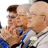 Globe/T. Rob Brown<br /> Residents, including James Loeffler, right, clap Tuesday morning, Feb. 21, 2012, during the grand re-opening of Mercy Village in Joplin.