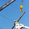 Globe/T. Rob Brown<br /> A utility crew from PAR Electric work Wednesday morning, Feb. 29, 2012, to straighten one of utility poles bent or knocked down by Tuesday night's severe storm on South Rouse, near Centennial Drive, in Pittsburg, Kan.