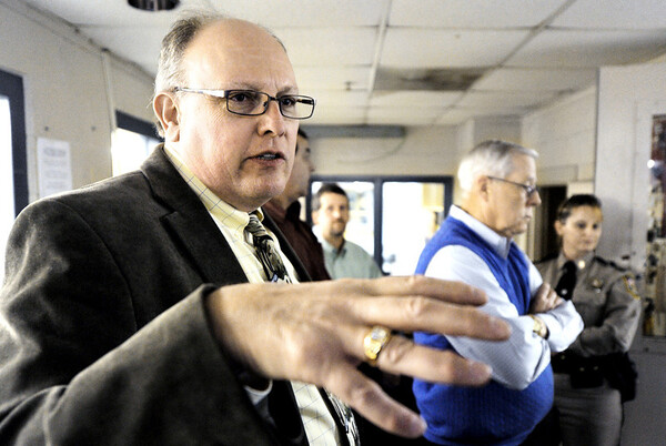 Globe/T. Rob Brown<br /> Paul Chastant, with Carter Gobal Lee, speaks to a group of contractors looking at upgrading the Jasper County Jail's security and locking systems, Commissioner Jim Honey, and Jasper County Sheriff's Department representatives Wednesday afternoon, Feb. 22, 2012, while in the jail control in Carthage.