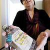 Globe/T. Rob Brown<br /> M. Raylene Lamb, of Splitlog, president of the McDonald County Historical Society, holds up a 1938 bottle of 90-proof whiskey Friday morning, Feb. 24, 2012, which was found in the McDonald County Courthouse.