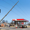 Globe/T. Rob Brown<br /> Due to Tuesday night's severe storm, some utility poles in Pittsburg, Kan., run the risk of falling near a convenience store Wednesday afternoon, Feb. 29, 2012, on South Rouse, near Centennial Avenue. PAR Electric crews arrived on scene to pull the poles back into their proper alignment.