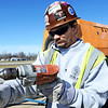 Globe/T. Rob Brown<br /> Jeremiah Casdorph, an iron worker from Carrol County working with James H. Drew Corp. of Sedalia, installs one of many new dileniators (metal poles with reflectors) along Missouri 71 Highway, soon to be renamed I-49, near Jasper Wednesday morning, Feb. 23, 2012. New mile marker signs are also being installed as the state highway is being transformed into an interstate.