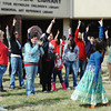 Globe/T. Rob Brown<br /> Shelli Jones of Joplin, right, leads a group of women in a dance for the international Billion Women Rise event in front of the Joplin Public Library Thursday afternoon, Feb. 14, 2013. Another leader, Stacey Sarakinis of rural Joplin, is at left.