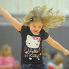 Globe/Roger Nomer<br /> Daelyn Perez, 6, jumps during a game of Jump the River at the Boys and Girls Club on Monday afternoon.