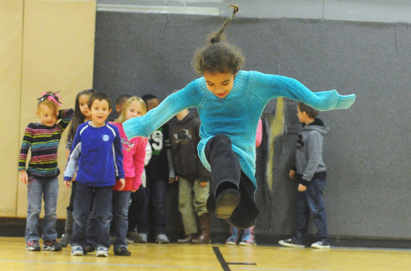 Globe/Roger Nomer<br /> Leighanna Underwood, 6, leaps during a game at the Boys and Girls Club on Monday afternoon.