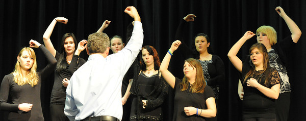 Globe/T. Rob Brown<br /> Dr. David Sharlow, director of choral activities at Missouri Southern State University, works with the altos of the Frontenac (Kan.) High School Choir Wednesday afternoon, Feb. 20, 2013, during the CNC Music Festival at the Baxter Springs (Kan.) High School auditorium.