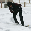 Globe/Roger Nomer<br /> Marquise Sellers, an Ozark Christian College sophmore from Van Nuys, Calif., tries his hand as snowboarding behind a car in the parking lot of the college on Thursday.