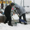 Globe/Roger Nomer<br /> Joseph Ness, 11, left, and John Newman, 13, clear the sidewalk in front of Mohaska Farmhouse on Thursday morning.  The pair was looking to make extra money clearing walks during the storm.