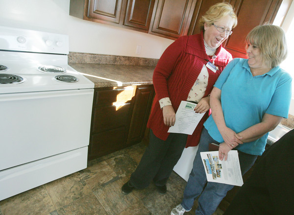 Globe/Roger Nomer<br /> Shelly Goerz, left, excitedly congratulates Michelle Wilson on her new Habitat home on Tuesday.  Goerz's home was located at this location before the tornado destroyed it.