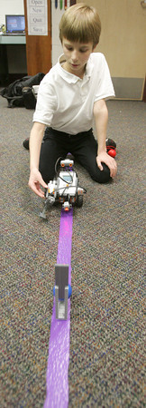 Globe/Roger Nomer<br /> Luke Goodhope, fifth grader at Thomas Jefferson, lines up his robot to kick a ball on Tuesday afternoon.