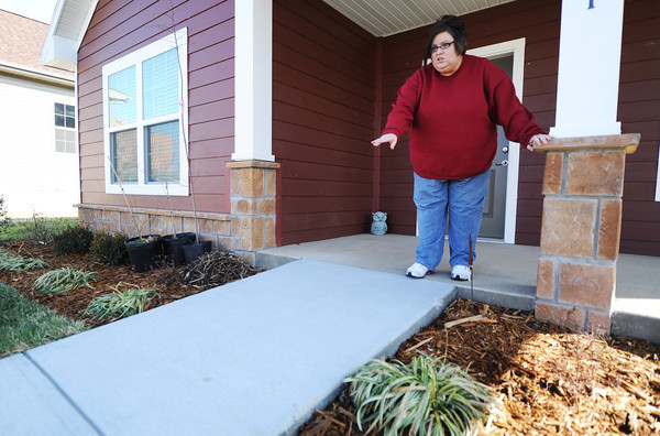 Globe/T. Rob Brown<br /> April Sidenstricker shows the accessibility ramp in front of her home Friday morning, Feb. 8, 2013. She said she used to have to go up and down stairs, which was difficult for her.