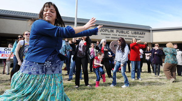 Globe/T. Rob Brown<br /> Shelli Jones, left, of Joplin, leads a group of women in a dance for the international Billion Rising event in front of the Joplin Public Library Thursday afternoon, Feb. 14, 2013.