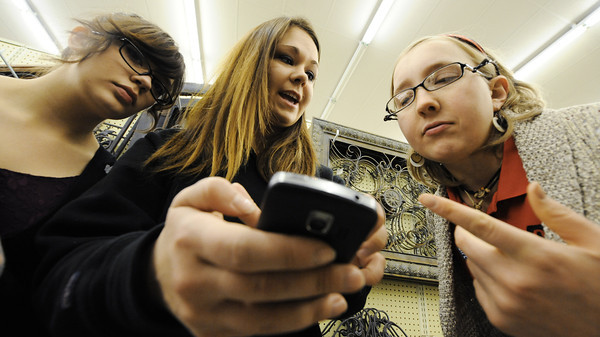 Globe/T. Rob Brown<br /> A group of Pittsburg State University SIFE (Students in Free Enterprise) members, from left, Makayla Hamm, Kaitlin Bristley and Lindsey Greve look at pictures on Bristley's phone as they decide which decor items to buy during a shopping trip to Hobby Lobby Saturday morning, Feb. 23, 2013, in Joplin. PSU's SIFE has been helping the Grace House event center in Galena, Kan. The house is owned by Richard and Kay Deardorff.