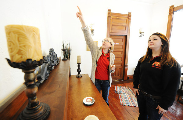 Globe/T. Rob Brown<br /> Pittsburg State University SIFE (Students in Free Enterprise) members, Kaitlin Bristley, right, and Lindsey Greve decide which decor items to place Saturday morning, Feb. 23, 2013, at the Grace House event center in Galena, Kan. PSU's SIFE has been helping clean up and decorate the house owned by Richard and Kay Deardorff.