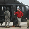 Globe/Roger Nomer<br /> Jeff Gibson, director of budgeting and operations at Missouri Southern, gives the flight crew a thumbs up as he at Darren Fullerton, MSSU vice president for student affairs, exit the Black Hawk Helicopter on Wednesday.
