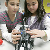 Globe/Roger Nomer<br /> Jasmine Michalopoulos, left, and Audrey Neighmond, both fifth graders at Thomas Jefferson, program their robots on Tuesday afternoon.