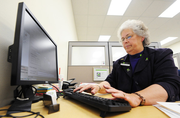 Globe/T. Rob Brown<br /> Cleta Mills, office leader and tax preparer for the H&R Block office at 1010 S. Madison, Webb City, prepares taxes for a client Thursday afternoon, Feb. 28, 2013.