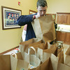 Globe/Roger Nomer<br /> Stetson Beck, a senior at Carl Junction High School and chapter president of the FFA, helps unload food donations from the Missouri Farm Bureau at the Ronald McDonald House on Tuesday morning.  This is the 15th year the bureau has donated food to the house.