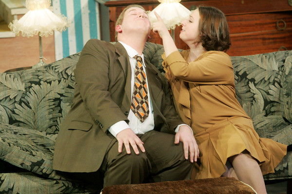 """Globe/Roger Nomer<br /> Abigail Railsback, as Patricia Harrington, welcomes home Hunter Dowell, as Bill Harrington, during rehearsal for """"The Patsy"""" at Missouri Southern on Tuesday."""